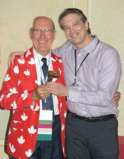 Outgoing MASO President Dr. Normand Boucher presents the gavel to Incoming President Dr. Russell Sandman